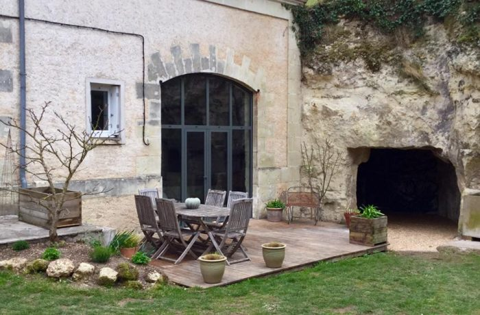 a typical winegrower's home dug into the limestone hillside loire wine tours
